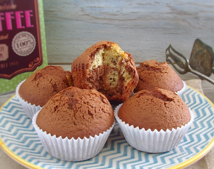 Vanilla and chocolate muffins on a dish