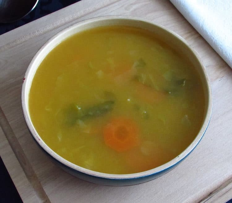 Vegetable soup with savoy cabbage on a soup bowl
