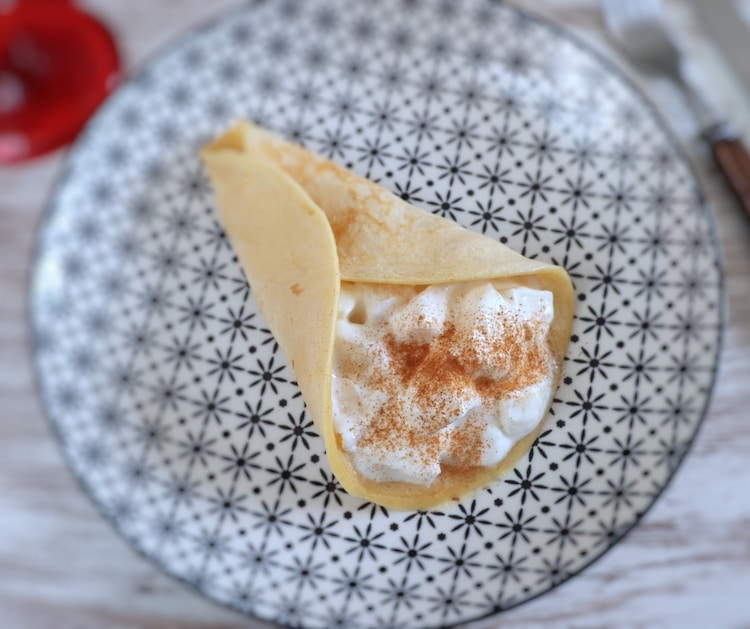 Crepe with fruit and yogurt on a plate