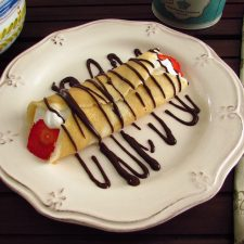 Crepe with strawberries on a plate