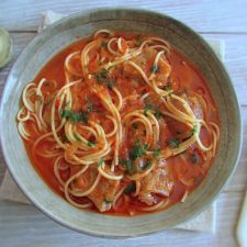 Stewed meat with spaghetti on a dish bowl