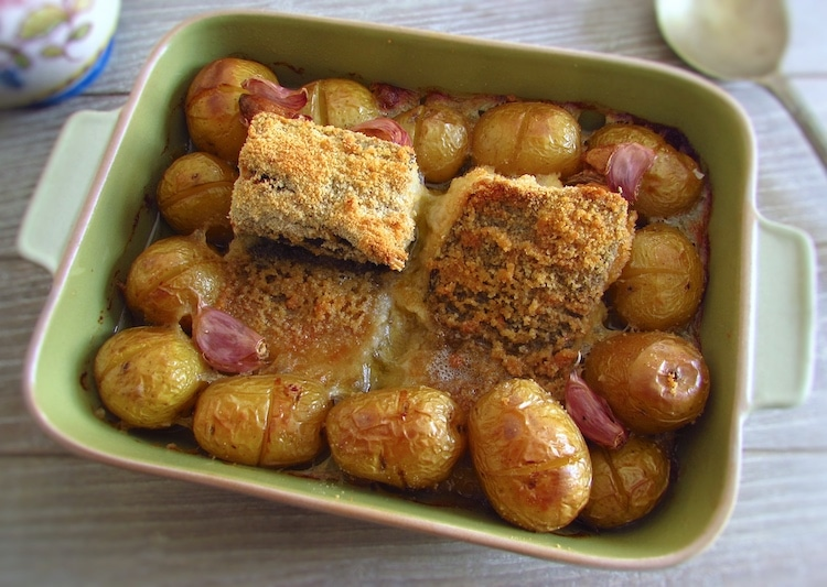 Breaded cod in the oven on a baking dish