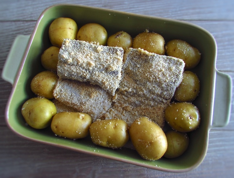 Potatoes and cod on a baking dish
