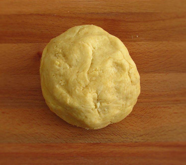 Pie dough on a wooden board