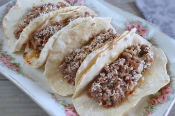Beef and pork tacos on a platter