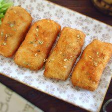 Breaded fish loins on a platter