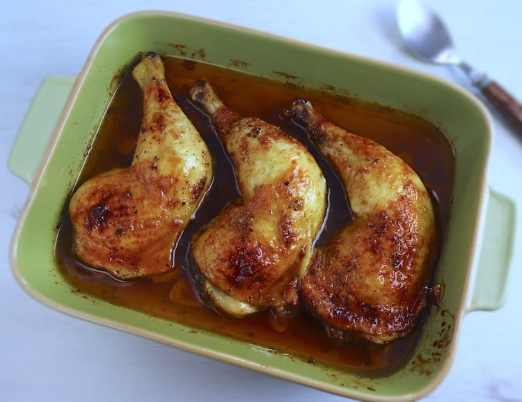 Chicken legs in the oven with honey on a baking dish