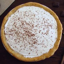 Chocolate and chantilly pie on a pie pan