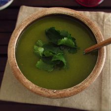 Coriander soup on a soup bowl