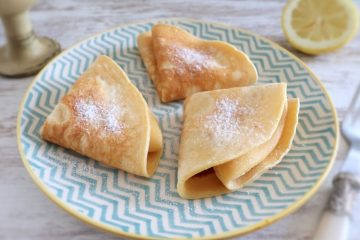 Crepes with lemon and sugar on a plate