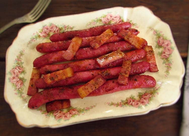 Fresh sausages in the oven on a platter