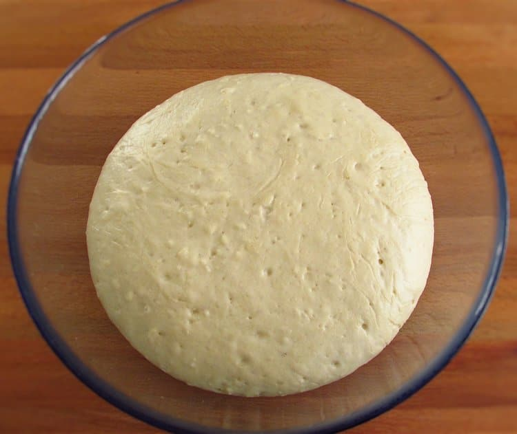 Garlic bread dough on a glass bowl