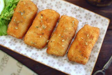Lombos de peixe panados numa travessa