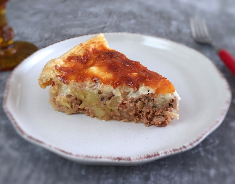 Slice of meat and potato pie on a plate