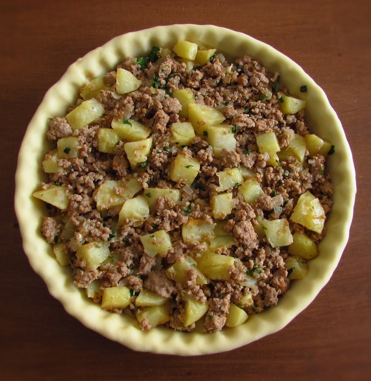 Pie filled with meat and potato