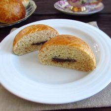 Milk bread filled with chocolate on a plate