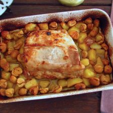 Pork loin with chestnuts in the oven on a baking dish
