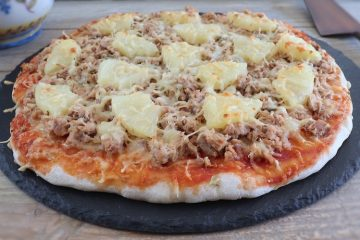 Tuna and pineapple pizza on a table
