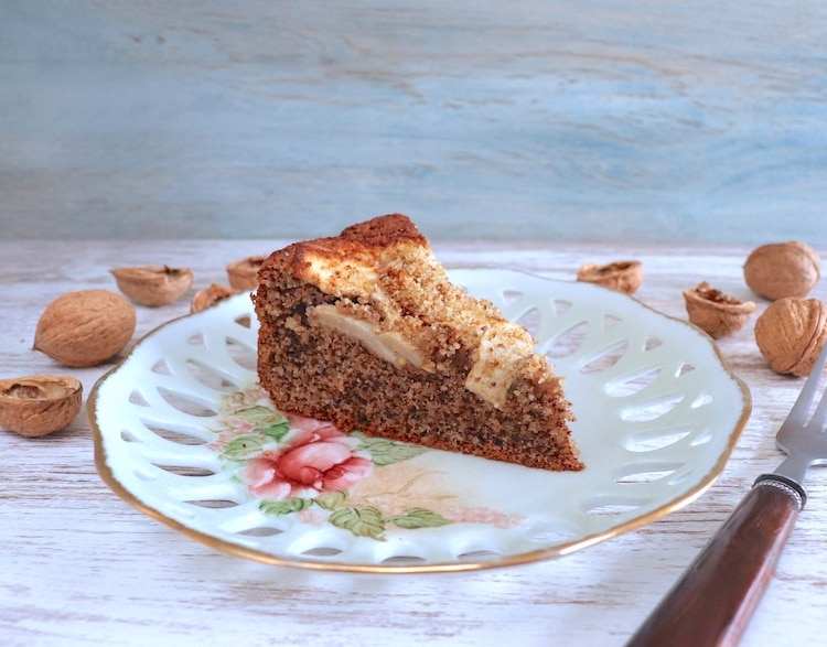 Slice of walnut and apple cake on a plate