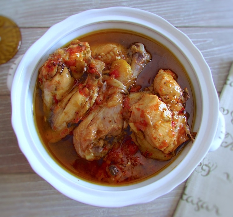 Chicken in tomato sauce on a tureen