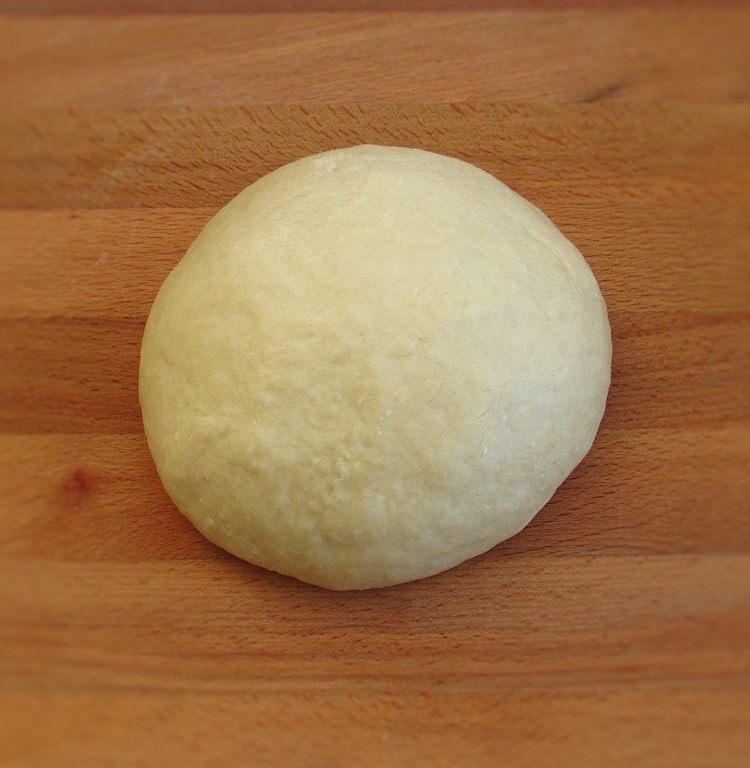 Milk bread dough on a wooden board