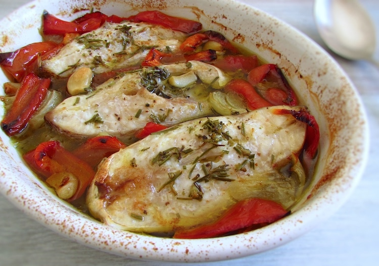 "Snapper in the oven ""Portuguese style"" on a baking dish"
