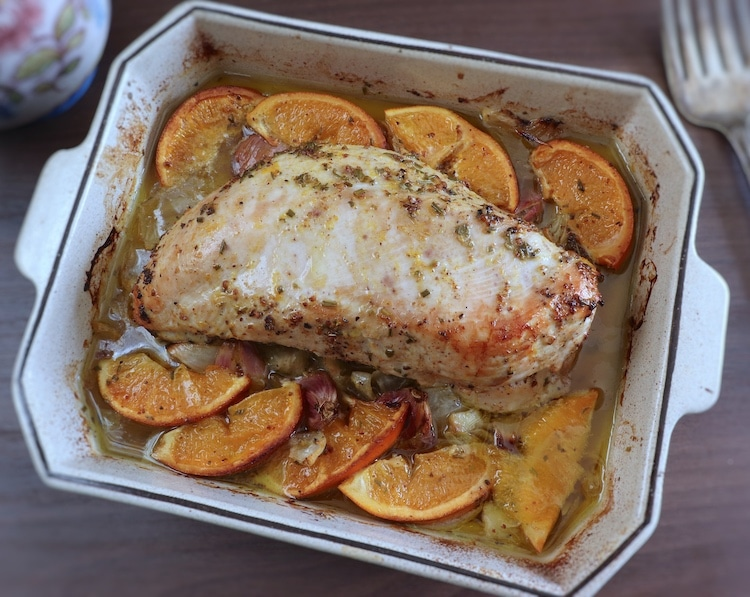 Turkey loin with orange on a baking dish