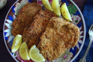 Breaded pork steaks in the oven on a plate