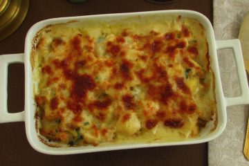 Cod gratin in the oven with shrimp on a baking dish