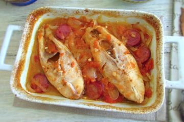Snapper with chouriço in the oven on a baking dish