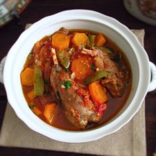 Stewed rabbit with carrots on a tureen