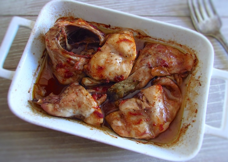 Roasted rabbit in the oven on a baking dish