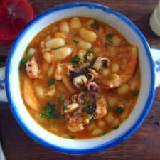 Stewed cuttlefish with white beans on a small tureen