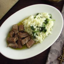 Veal cubes with coriander rice on a platter