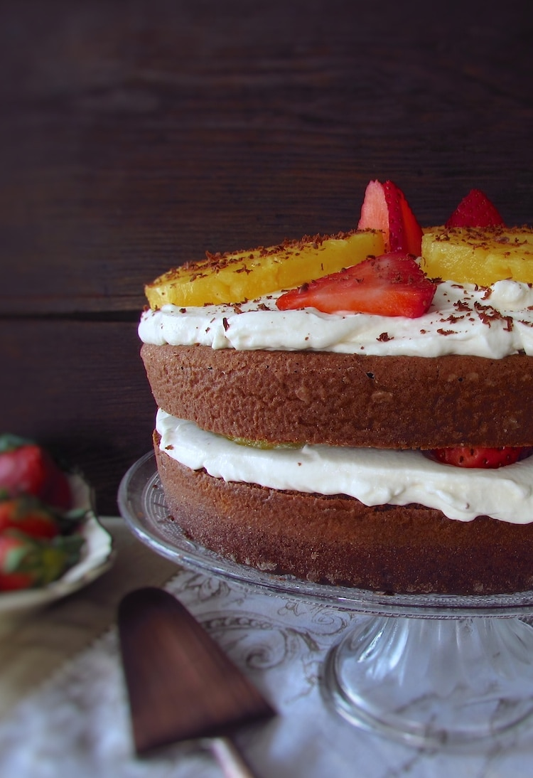 Chocolate cake with fruit and chantilly on a plate