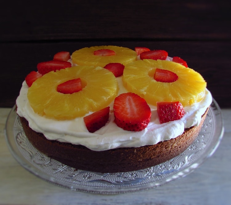 Half cake filled with chantilly, strawberries and pineapple slices