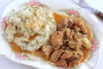 Pork with Portuguese migas (crumbs) on a platter