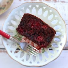 Slice of simple chocolate triple berry cake on a plate