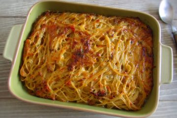Tuna with spaghetti in the oven on a baking dish