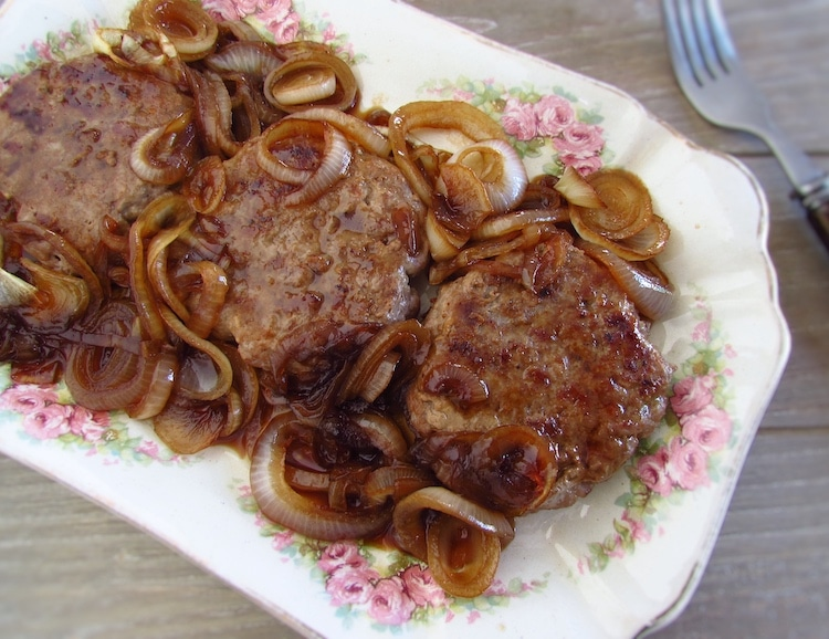 Burger with caramelized onion on a platter