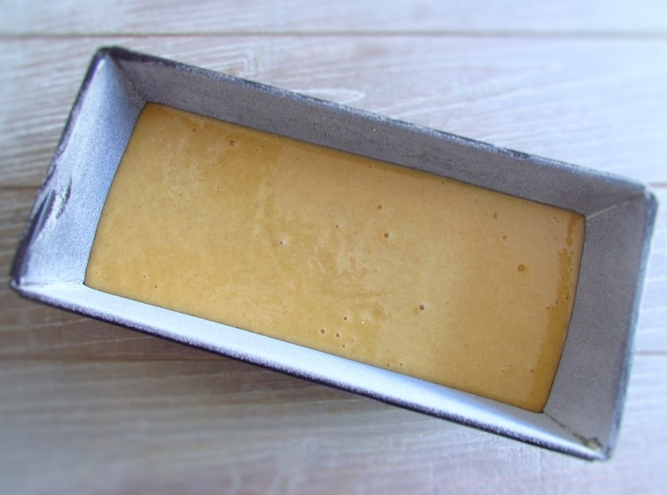 Mango cake dough on a loaf tin