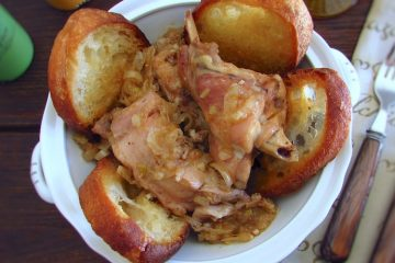 Stewed rabbit with fried bread on a tureen