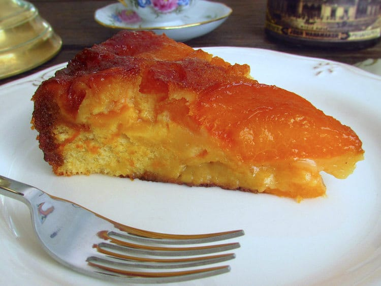 Caramelized apricot cake slice on a plate
