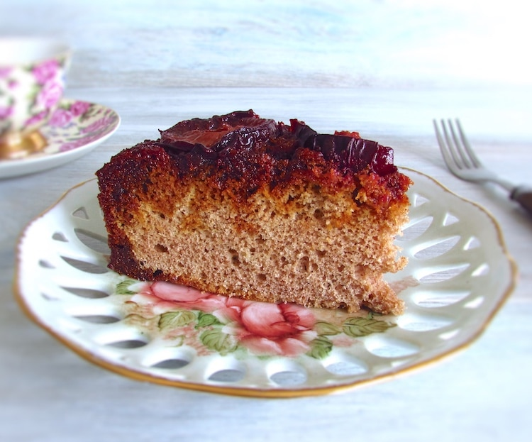 Caramelized plum cake slice on a plate