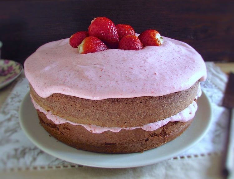 Chocolate cake with strawberry cream on a plate