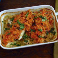 Cod in the oven with tomato Portuguese cornbread on a baking dish
