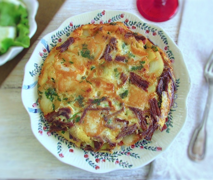 Spanish omelette with meat on a plate