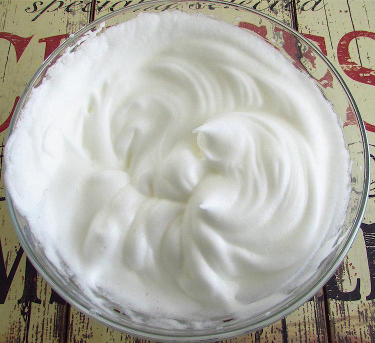 Beaten egg whites in a bowl