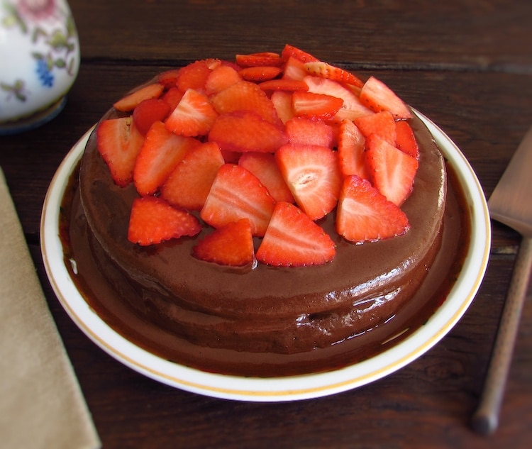 Coffee cake with chocolate mousse and strawberries on a plate