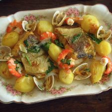 Cod in the oven with shrimp and clams on a platter